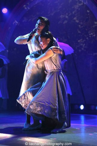Melody Butiu as Estrella and Jaygee Macapugay as Imelda Marcos in HERE LIES LOVE. Photo by Lia Chang