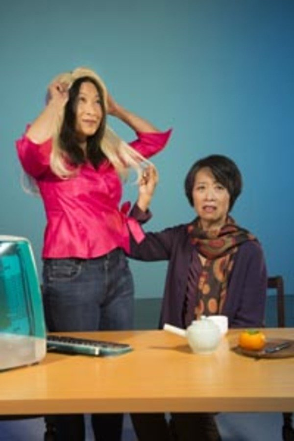 Sayuri (Elizabeth Pan) embraces Western fashion to her mother Natsuko's (Jeanne Sakata) dismay in TheatreWorks Silicon Valley's regional premiere of Velina Hasu Houston's international comic drama, Calligraphy presented at the Lucie Stern Theatre in Palo Alto, March 8 to April 2, 2017. Photo by Kevin Berne