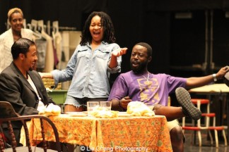"""Crystal Dickinson, Jason Dirden, Charlie Hudson III and Christina Acosta Robinson in rehearsal for Two River Theater's production of August Wilson's """"Seven Guitars."""" Photo by Lia Chang"""