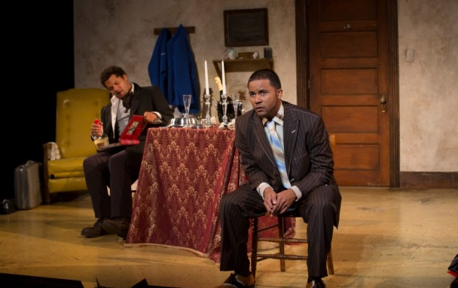 Brandon J. Dirden (left, as Lincoln) and Jason Dirden (as Booth) in TOPDOG/UNDERDOG at Two River Theater Company in Red Bank, NJ. (Photo credit: T. Charles Erickson)