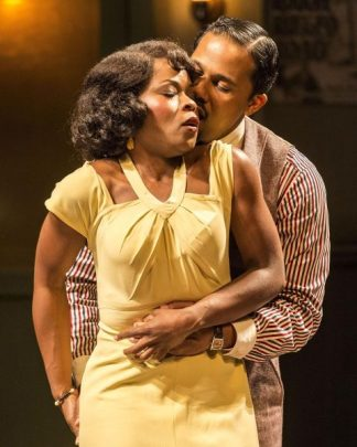 """Nija Okoro as Ma's girlfriend Dussie May gets some sweet talk from Levee (Jason Dirden): """"Can my red rooster go in your brown hen?"""" Photo by Craig Schwartz."""