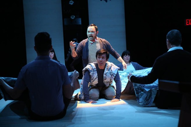 "Orville Mendoza and Steven Eng, center, and the cast of ""Pacific Overtures"" by John Weidman and Stephen Sondheim, at Classic Stage Company. (Photo by Joan Marcus)"