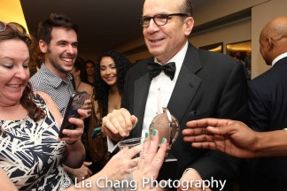 MTC's Barry Grove let everyone at the party touch the Tony for good luck. Photo by Lia Chang