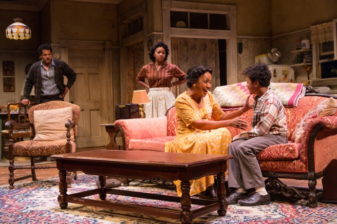 Brandon J. Dirden (Walter Lee Younger), Crystal A. Dickinson (Ruth Younger), Brenda Pressley (Lena Younger) and Owen Tabaka (Travis Younger) in A Raisin in the Sun at Two River Theater. Photo by T. Charles Erickson
