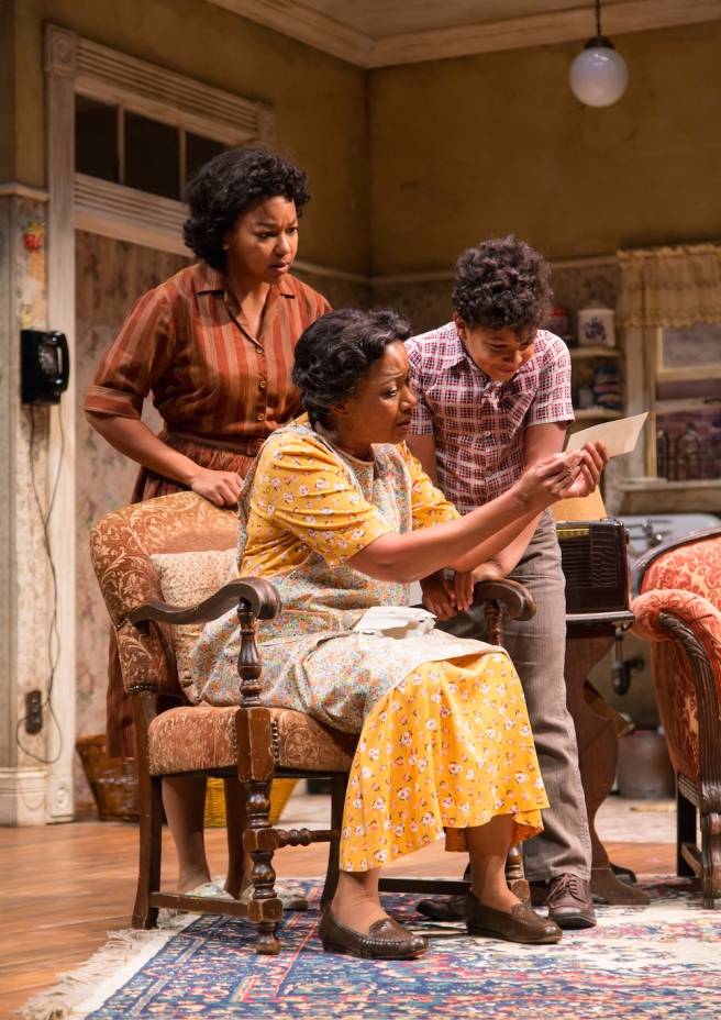 Crystal A. Dickinson (Ruth Younger), Brenda Pressley (Lena Younger) and Owen Tabaka (Travis Younger) in A Raisin in the Sun at Two River Theater. Photo by T. Charles Erickson
