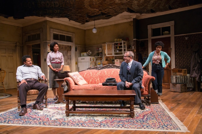 Brandon J. Dirden (Walter Lee Younger), Crystal A. Dickinson (Ruth Younger), Nat DeWolf (Karl Lindner) and Jasmine Batchelor (Beneatha Younger) in A Raisin in the Sun at Two River Theater. Photo by T. Charles Erickson