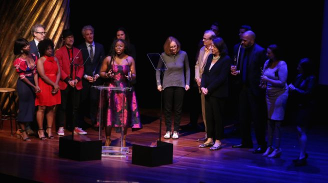 NEW YORK, NY - MAY 06: The cast of School Girls; or, The African Mean Girls Play (L) accepts the award for Outstanding Play in a tie onstage during the 33rd Annual Lucille Lortel Awards on May 6, 2018 in New York City.| (Photo by Jemal Countess/Getty Images for Lucille Lortel Awards)