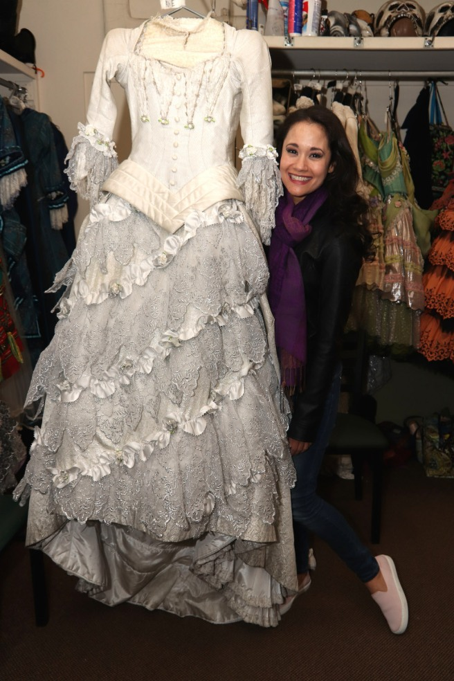 Ali Ewoldt in the costume room with her final costume of the show. Photo by Lia Chang