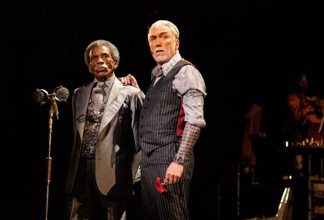 André De Shields as Hermes and Patrick Page as Hades in HADESTOWN. Photo by Helen Maybanks