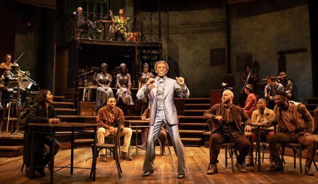 André De Shields as Hermes and the company in HADESTOWN. Photo by Helen Maybanks