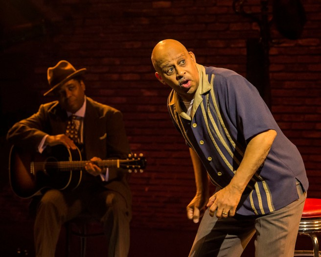 """L-R: Chris Thomas King (background) and Ruben Santiago-Hudson in the Center Theatre Group production of """"Lackawanna Blues."""" Written and directed by Santiago-Hudson, """"Lackawanna Blues"""" will play at the Mark Taper Forum through April 21, 2019. Photo by Craig Schwartz."""