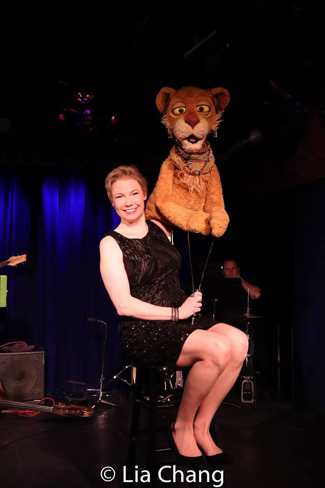 Jennifer Barnhart and Cleo the Lion. Photo by Lia Chang