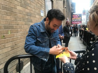 Marc delaCruz sign autographs at the Richard Rodgers Theatre in New York. Photo by Lia Chang