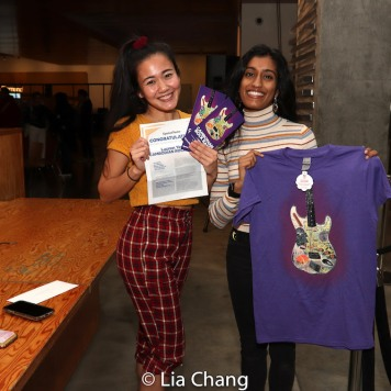 Lucky raffle ticket holders won the official CAMBODIAN ROCK BAND t-shirt and a pair of tickets. Photo by Lia Chang