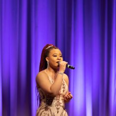 """Serrin Joy performing """"When You Believe."""" Courtesy of The Cooper Union/Photo by Marget Long"""