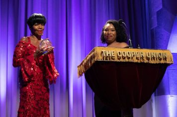 Melba Moore receiving Purple Crystal Honorary Award from Women of Color on Broadway co-founder Victoria Velazquez