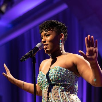 """Women of Color on Broadway co-founder Alexia Sielo performing """"I'm Every Woman."""" Courtesy of The Cooper Union/Photo by Marget Long"""