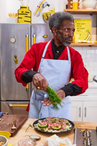Special guest André De Shields making Beet-Cured Salmon Breakfast Salad, as seen on Breakfast with Besser, Season 1. Photo courtesy of Food Network Kitchen