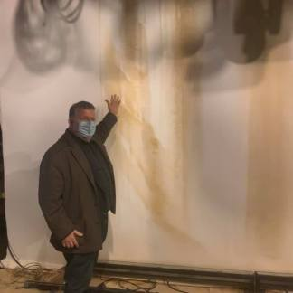 James Morgan stands in The York Theatre, which sustained water damage on January 4, 2021 after a water main break. Photo: James Morgan/Facebook