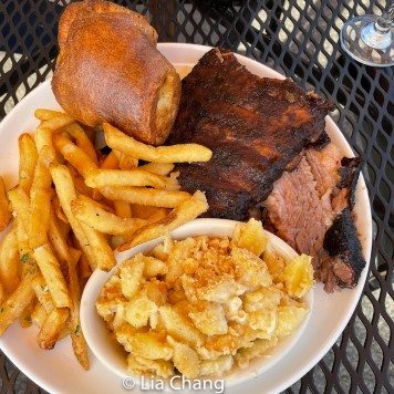 St. Louis style fatty BBQ brisket, St. Louis Cut ribs, white cheddar cracker mac and beef fat fries. Photo by Lia Chang